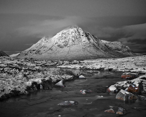 Buachaille Etive Mor in the snow river leading up to it