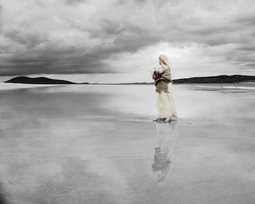 Bride on beach in Harris