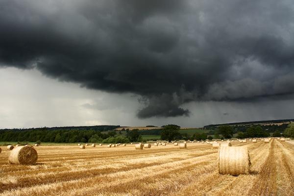 Dark rain cloud which is almost a funnel cloud