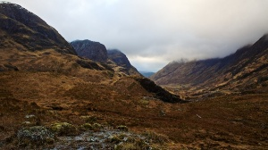 Looking along a geln past steep mountains either side in Glencoe.