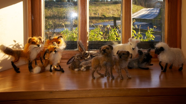 Range of felted animals including a fox, sheep , dogs and hares.