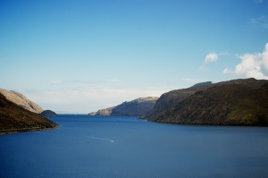 view down loch Seaforth which has hills on either side of deep blue water