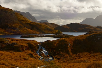 Loch and waterfall in the foreground.